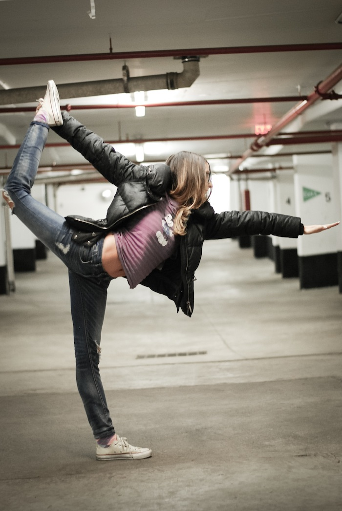 bow pose bikram yoga in street clothes